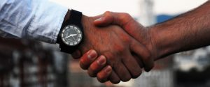 people shaking hands when meeting