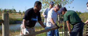 volunteers building a fence